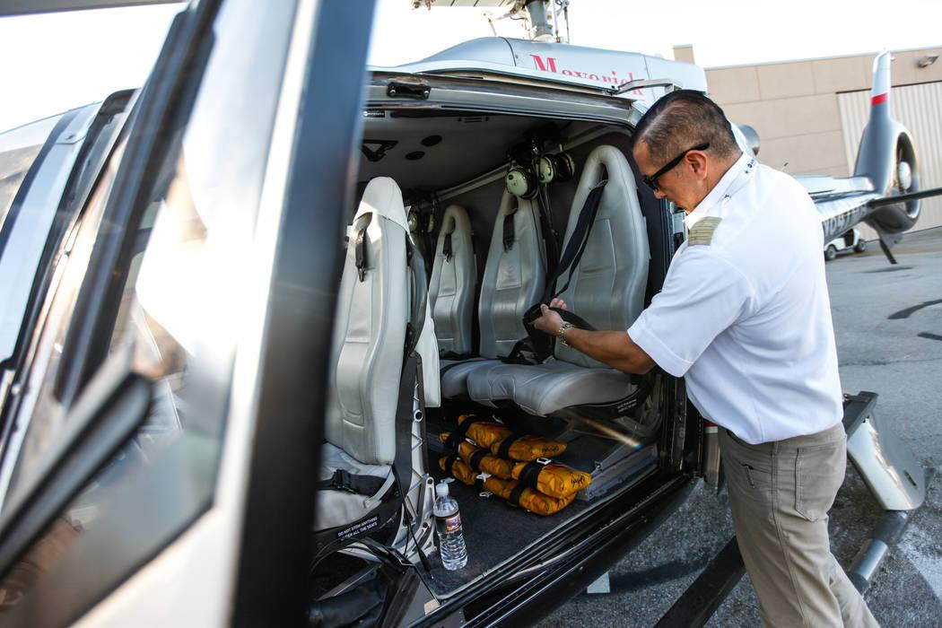 Maverick Helicopters Pilot Joe Munoz, 41, explains seatbelt functions as procedure before a flight in Las Vegas, Friday, Dec. 1, 2017. Joel Angel Juarez Las Vegas Review-Journal @jajuarezphoto