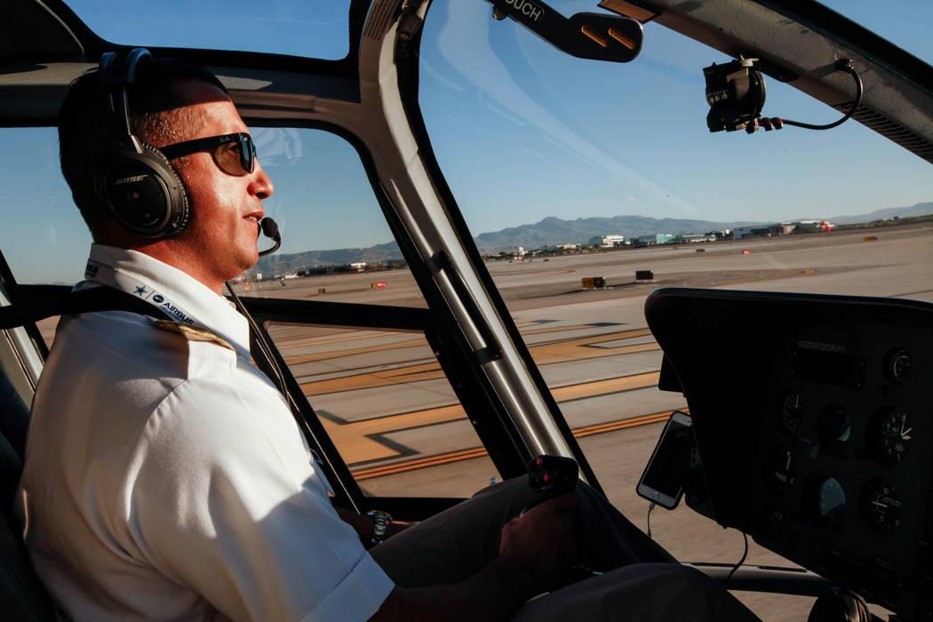 Maverick Helicopters Pilot Joe Munoz, 41, lands a helicopter at McCarran International Airport in Las Vegas, Friday, Dec. 1, 2017. Joel Angel Juarez Las Vegas Review-Journal @jajuarezphoto