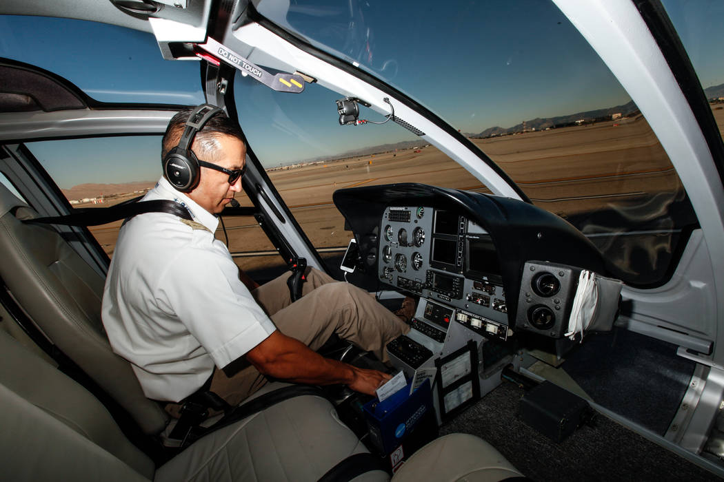 Maverick Helicopters Pilot Joe Munoz, 41, checks systems before takeoff in Las Vegas, Friday, Dec. 1, 2017. Joel Angel Juarez Las Vegas Review-Journal @jajuarezphoto