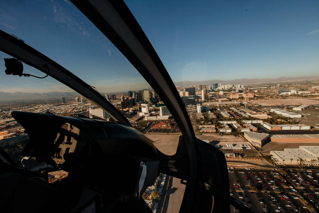 A view of Las Vegas as seen from inside a helicopter piloted by Joe Munoz, 41, of Maverick Helicopters, Friday, Dec. 1, 2017. Joel Angel Juarez Las Vegas Review-Journal @jajuarezphoto