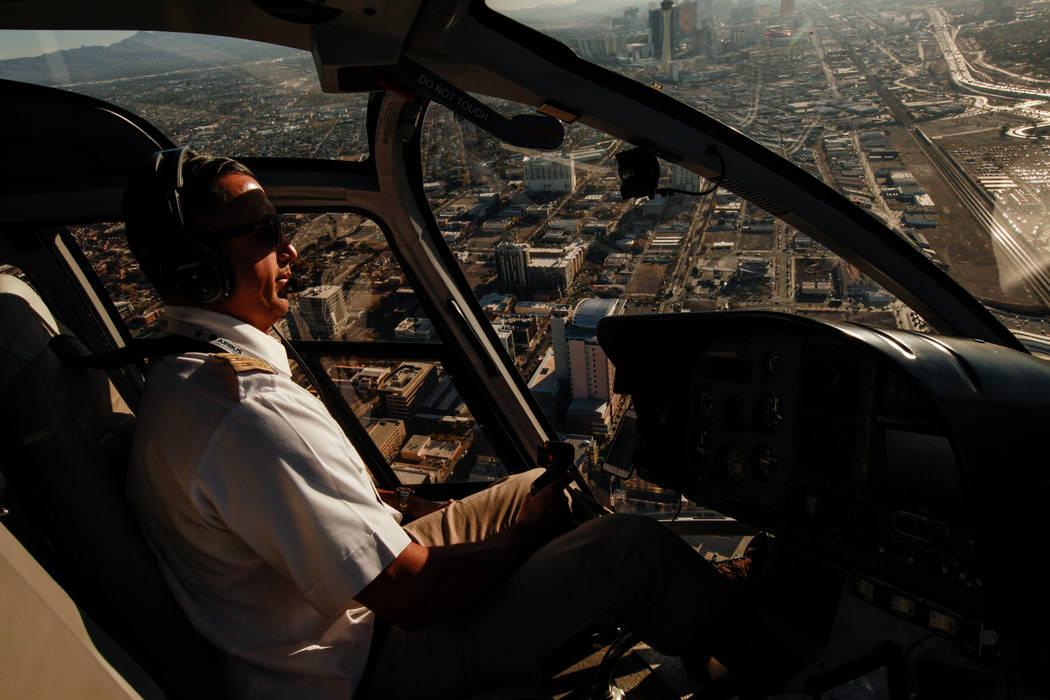 Maverick Helicopters Pilot Joe Munoz, 41, flies above Las Vegas, Friday, Dec. 1, 2017. Joel Angel Juarez Las Vegas Review-Journal @jajuarezphoto