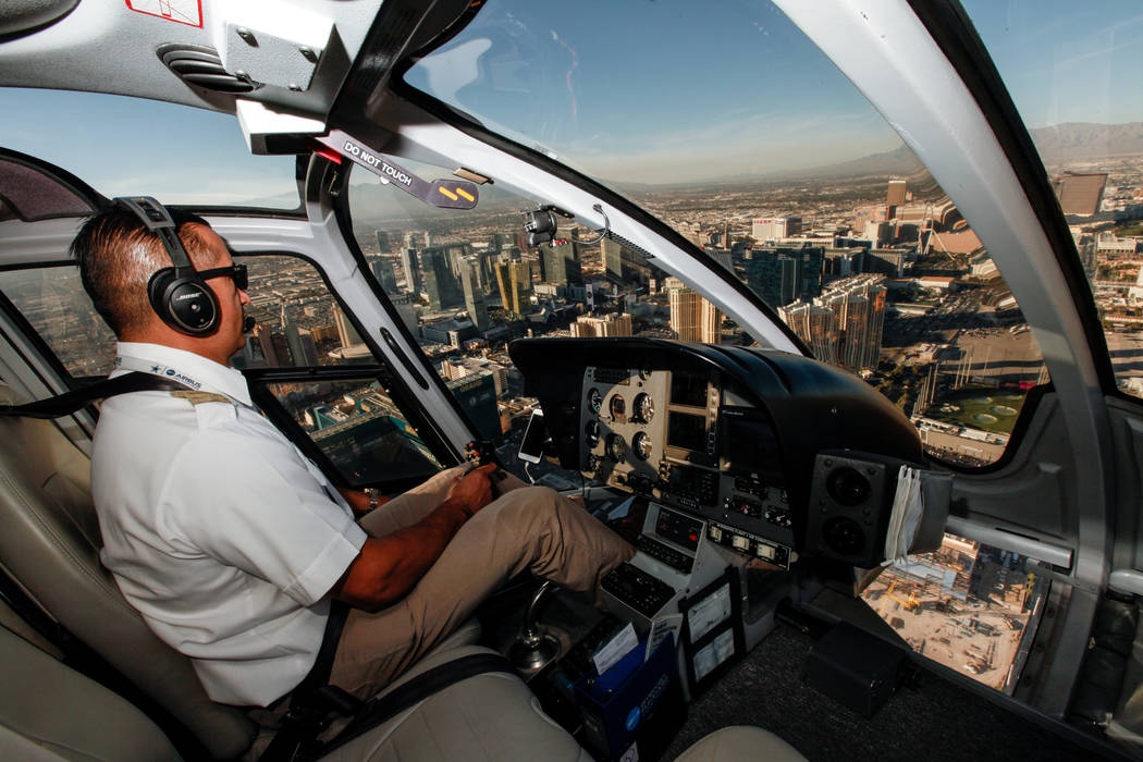 Maverick Helicopters Pilot Joe Munoz, 41, flies near the Strip in Las Vegas, Friday, Dec. 1, 2017. Joel Angel Juarez Las Vegas Review-Journal @jajuarezphoto