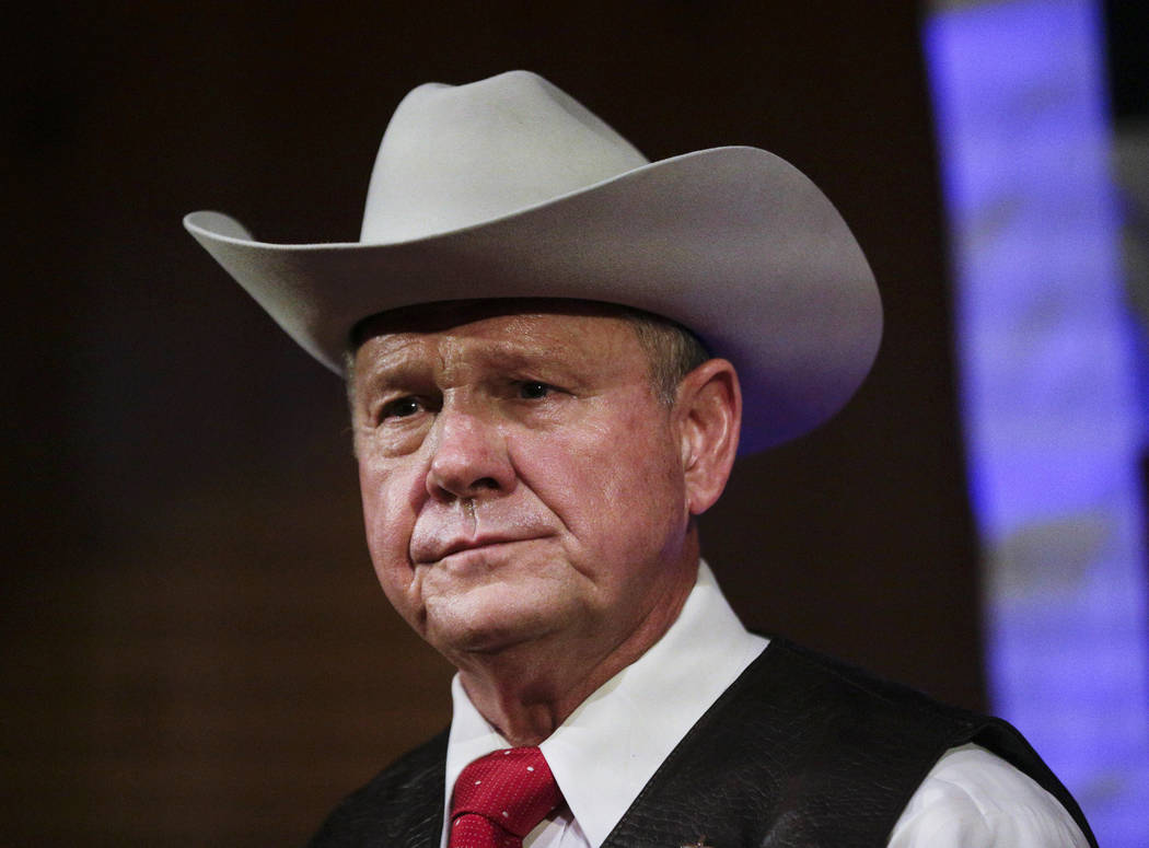 FILE - In this Monday, Sept. 25, 2017, file photo, former Alabama Chief Justice and U.S. Senate candidate Roy Moore speaks at a rally, in Fairhope, Ala. In the face of sexual misconduct allegation ...