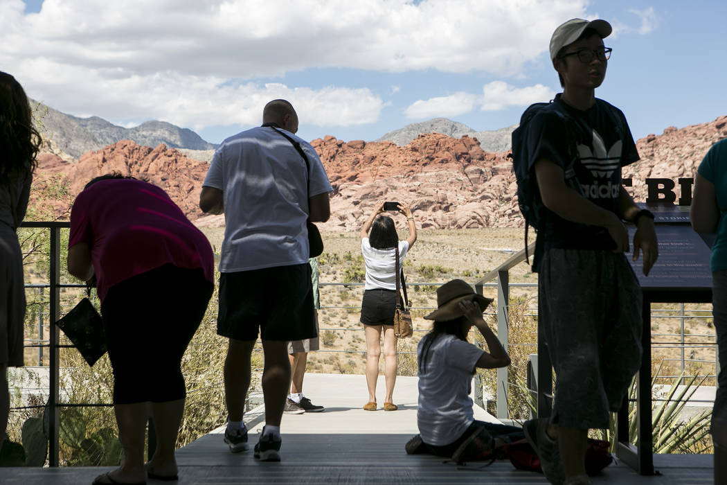 Visitors take photos at the Red Rock Canyon National Conservation Area's visitor center on Tuesday, Aug. 22, 2017, in Las Vegas. Bridget Bennett Las Vegas Review-Journal @bridgetkbennett