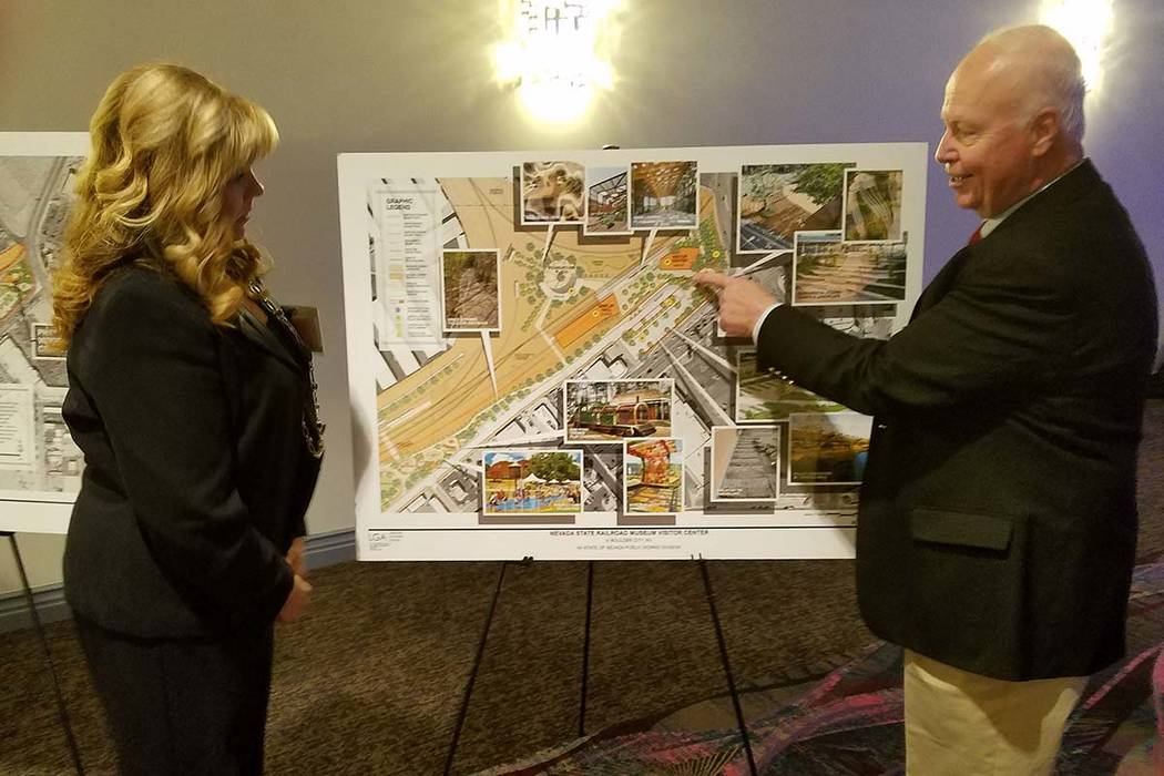 Peter Barton, administrator for the Division of Museums and History for the Nevada Commission on Tourism, shows a site plan for the Nevada State Railroad Museum in Boulder City to Jill Lagan, CEO  ...
