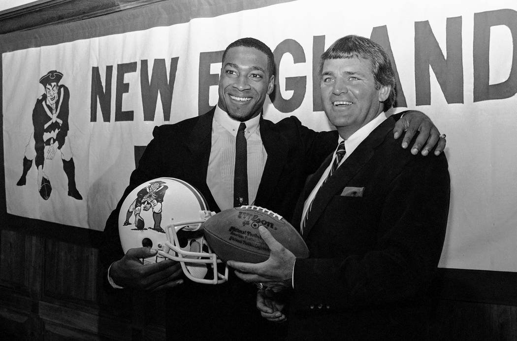 Irving Fryar, left, poses with New England Patriots coach Ron Meyer, right, during a press conference at Sullivan Stadium in Foxboro, Massachusetts, on Wednesday, April 11, 1984.   Fryar has signe ...