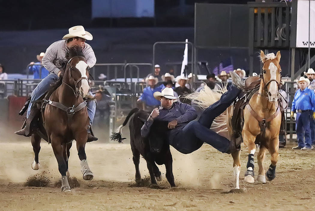 Former NFL tight end Bear Pascoe, shown wrestling a steer in San Bernardino, California, is trying to make the transition from the Super Bowl to the National Finals Rodeo. (Photo by Gene Hyder)