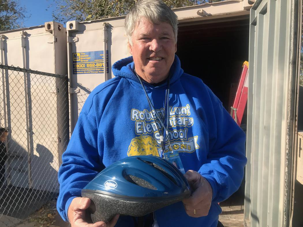 Physical education teacher Chris Regan holds a helmet that the Southern Nevada Biking Coalition donated to Robert Lunt Elementary on Dec. 10, 2017 at 2701 E. Harris Ave. (Kailyn Brown/View)