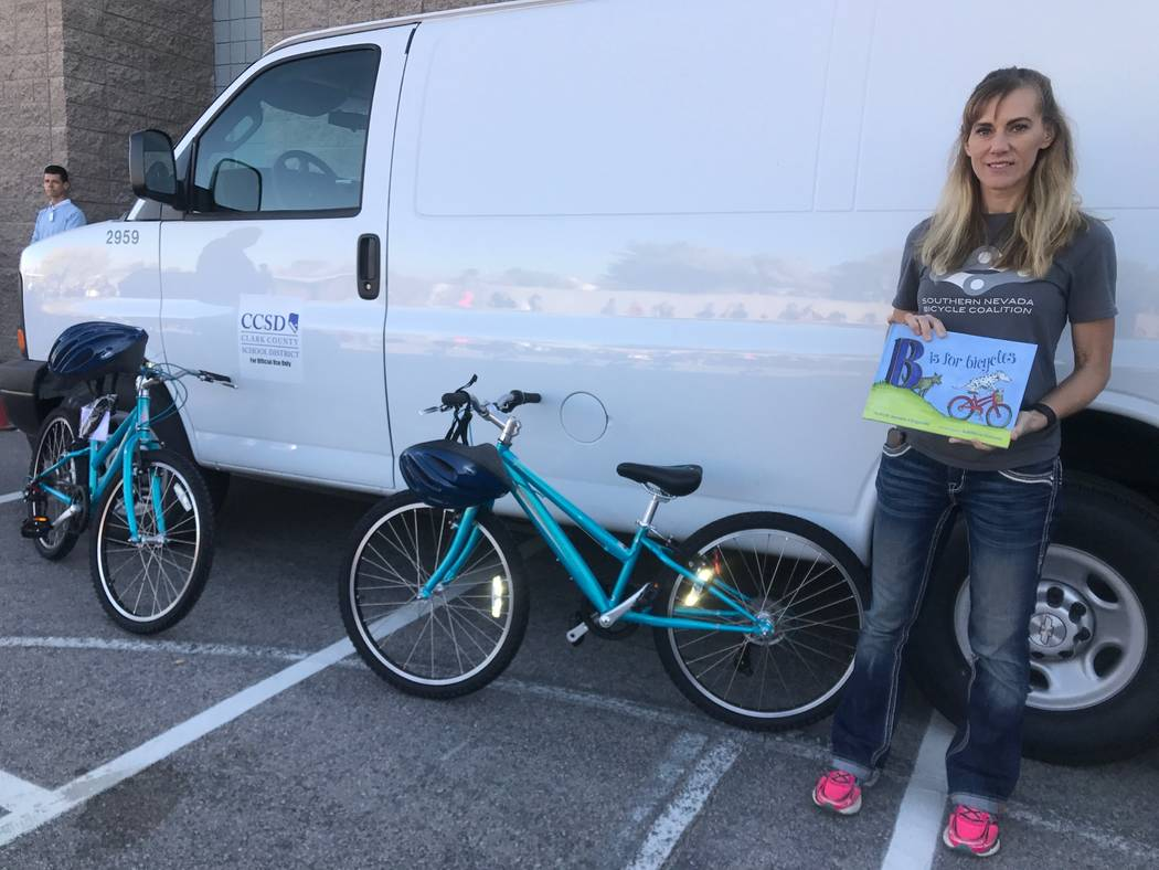Southern Nevada Biking Coalition founder and director Keely Brooks stands next to bikes that the coalition donated to Robert Lunt Elementary on Dec. 10, 2017 at 2701 E. Harris Ave. (Kailyn Brown/View)