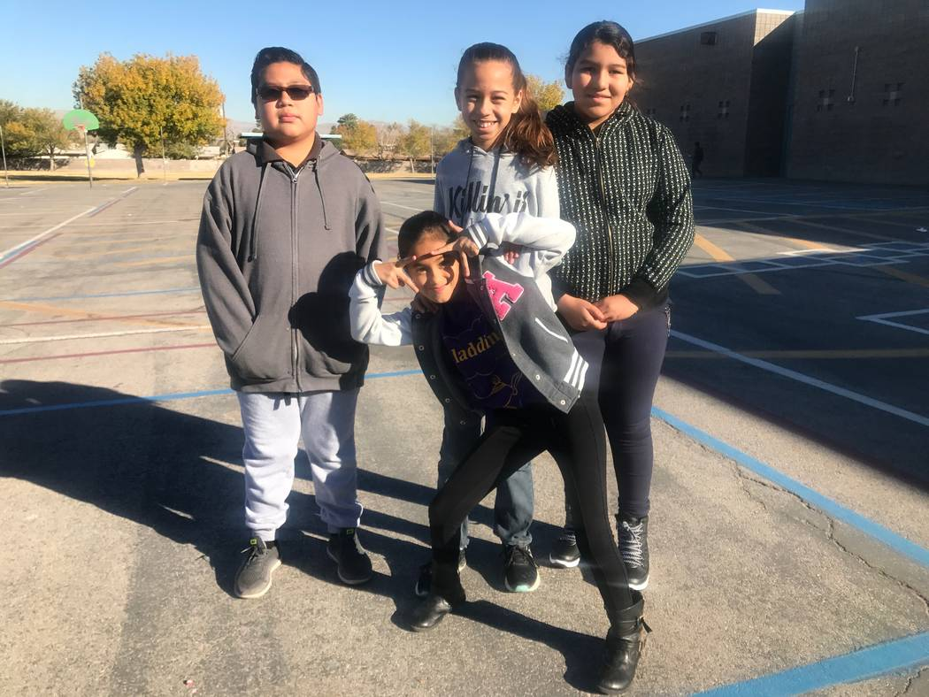 Robert Lunt Elementary School students, from left, Angel Barradas, Daysi Deltoro, Sydney Anderson and Fernanda Carrera pose for a portrait on Dec. 10, 2017 at 2701 E. Harris Ave. (Kailyn Brown/View)