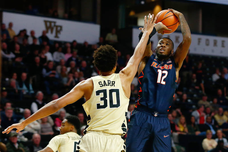 Nov 28, 2017; Winston-Salem, NC, USA; Illinois Fighting Illini forward Leron Black (12) shoots the ball against Wake Forest Demon Deacons center Olivier Sarr (30) in the second half at Lawrence Jo ...