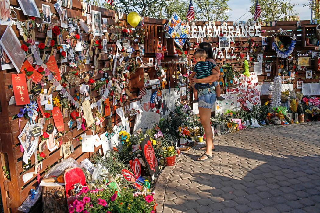 People visit a memorial at the Las Vegas Community Healing Garden in Las Vegas, Monday, Oct. 16, 2017, honoring the victims of the Route 91 Harvest Festival mass shooting. Joel Angel Juarez Las Ve ...