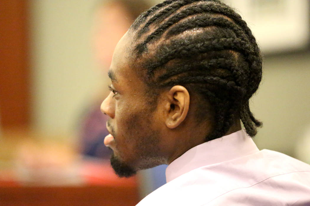 Bryan Clay, convicted of raping and murdering a mother and her 10-year-old daughter, watches a video of his daughter during the penalty phase of his trial at the Regional Justice Center in Las Veg ...