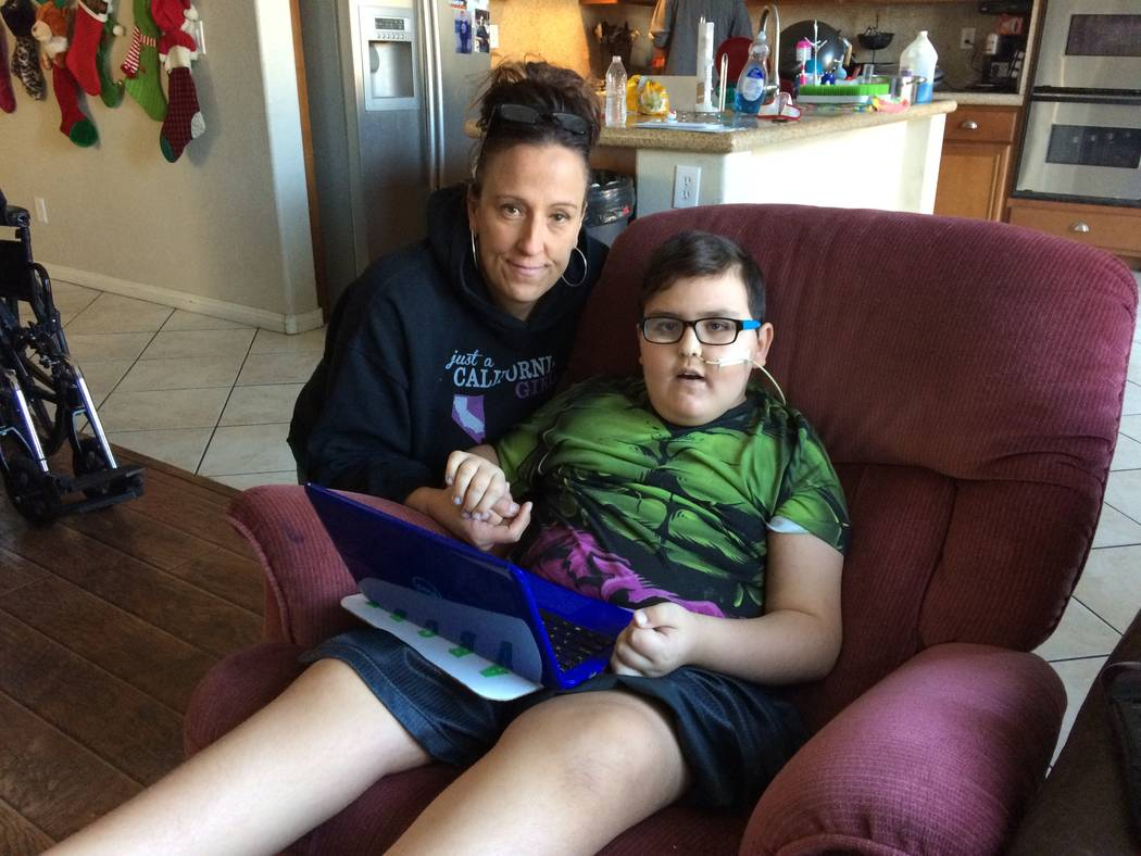 Tammi Faultersack Ramirez hugs her son, Jacob, Nov. 30, 2017, in their northwest home. He was diagnosed last December with a rare brain cancer and given nine months to live. When St. Jude's treatm ...