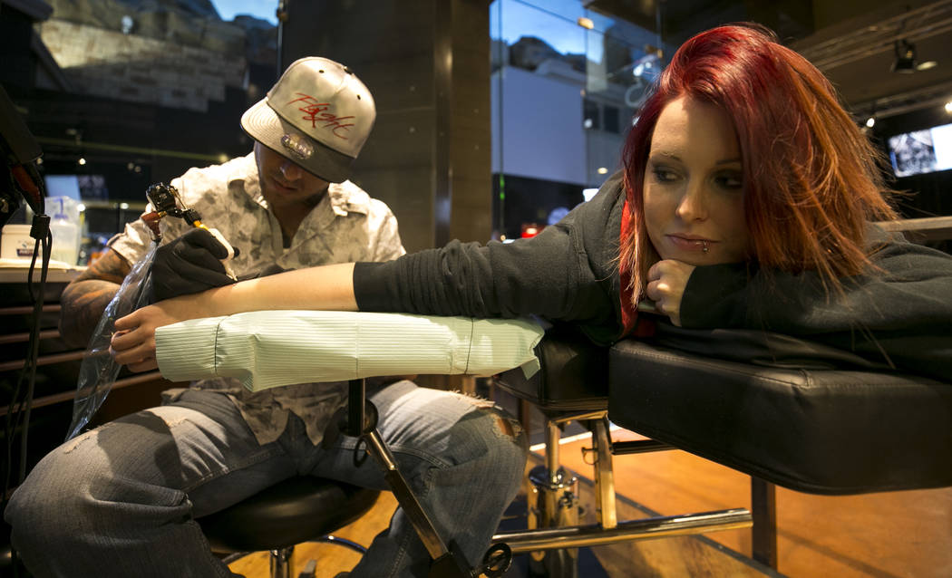 ICU nurse Devin Danner, 25, of Conway, Arkansas gets a Las Vegas tattoo from artist Jose Carlos Del Campo at Club Tattoo inside Planet Hollywood, Thursday, Oct. 5, 2017, in Las Vegas. Richard Bria ...