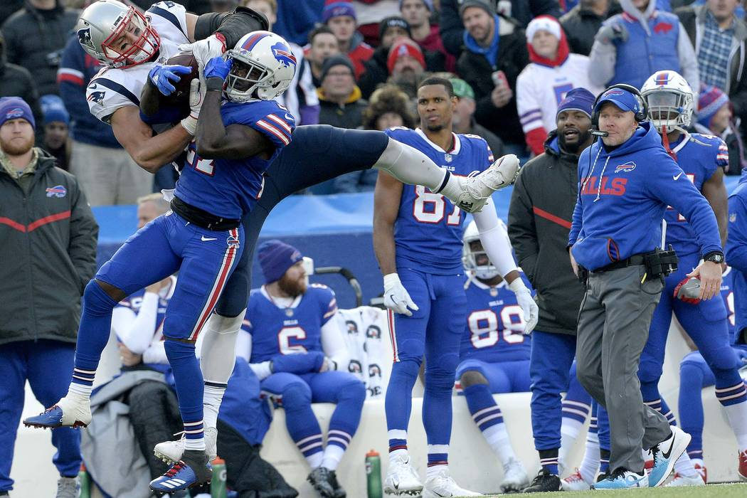 New England Patriots tight end Rob Gronkowski, left, makes a catch as Buffalo Bills cornerback Tre'Davious White (27) defends during the second half of an NFL football game, Sunday, Dec. 3, 2017,  ...