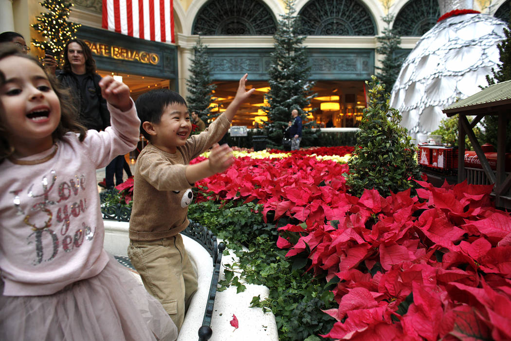 Tala Taherzadeh, 3, and Alden Sutheno, 3, cheer at the toy train at the Bellagio Conservatory & Botanical Gardens in Las Vegas, Monday, Dec. 4, 2017. Rachel Aston Las Vegas Review-Journal @roo ...