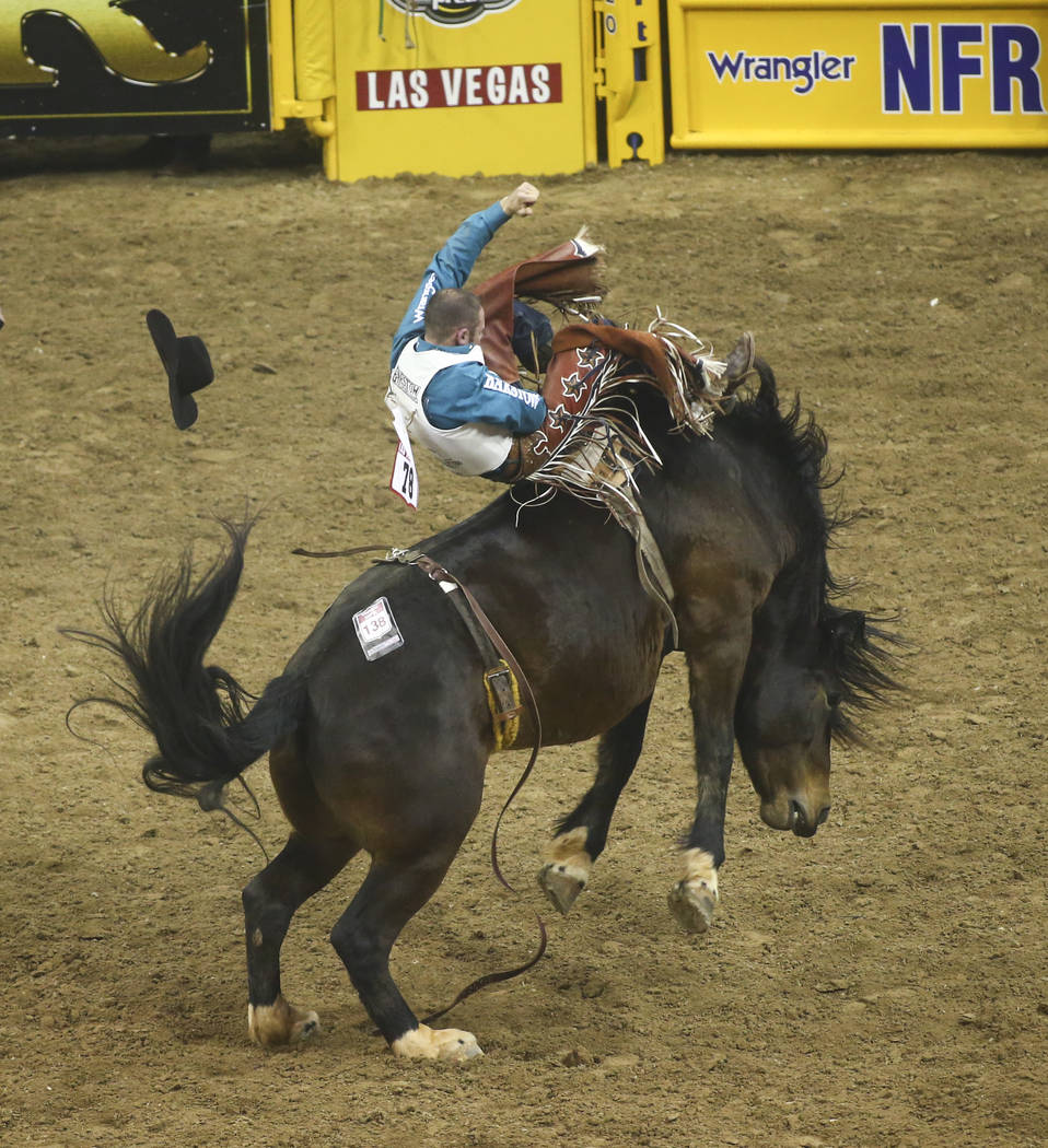 Mason Clements, who was born in Las Vegas and now resides in Utah, rides Times Up while competing in bareback riding during the opening night of the National Finals Rodeo at the Thomas & Mack  ...