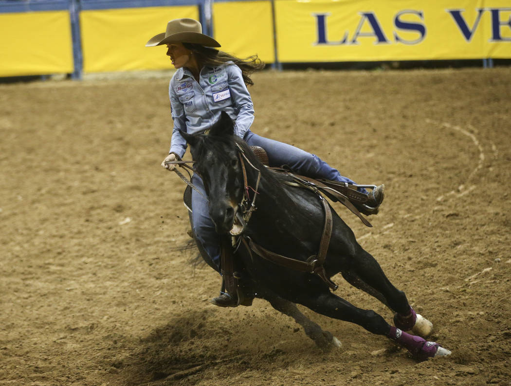 Nellie Miller of Cottonwood, Calif. competes in the barrel racing event during the second night of the National Finals Rodeo at the Thomas & Mack Center in Las Vegas on Friday, Dec. 8, 2017. C ...