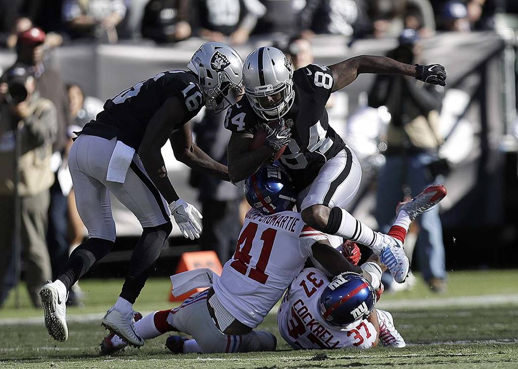 Oakland Raiders wide receiver Cordarrelle Patterson (84) runs against the New York Giants during the first half of an NFL football game in Oakland, Calif., Sunday, Dec. 3, 2017. (AP Photo/Marcio J ...