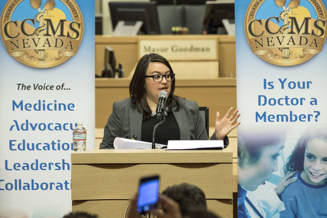 Elyse Monroy, a policy analyst serving the office of Governor Brian Sandoval, speaks during a town hall meeting on the opioid epidemic and its impact on local healthcare providers at Las Vegas Cit ...