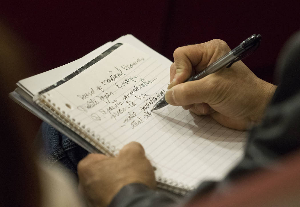 A man takes note during a town hall meeting on the opioid epidemic and its impact on local healthcare providers at Las Vegas City Hall on Tuesday, Dec. 5, 2017. Richard Brian Las Vegas Review-Jour ...