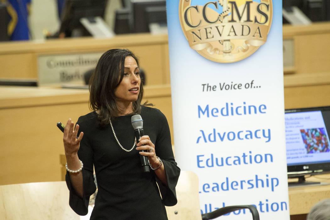 Stephanie Woodard, clinical psychologist with the Nevada Division of Public and Behavioral Health, speaks during a town hall meeting on the opioid epidemic and its impact on local healthcare provi ...