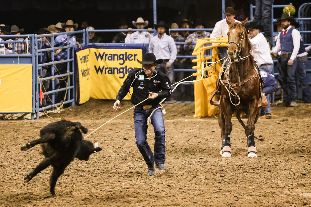Trevor Brazile of Decatur, Texas ties down a steer in the in the tie-down roping event during the fourth night of the 59th Wrangler National Finals Rodeo at the Thomas & Mack Center in Las Veg ...