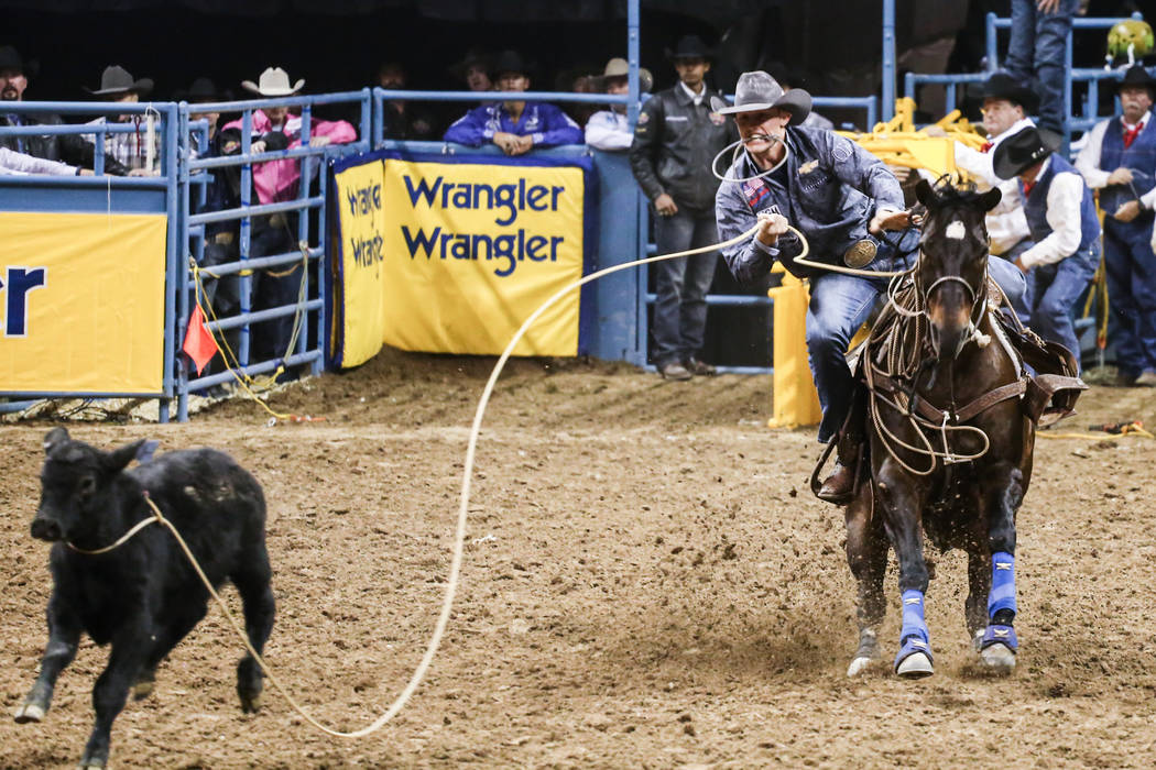 Tuf Cooper of Weatherford, Texas lassos a steer in the in the tie-down roping event during the fourth night of the 59th Wrangler National Finals Rodeo at the Thomas & Mack Center in Las Vegas, ...