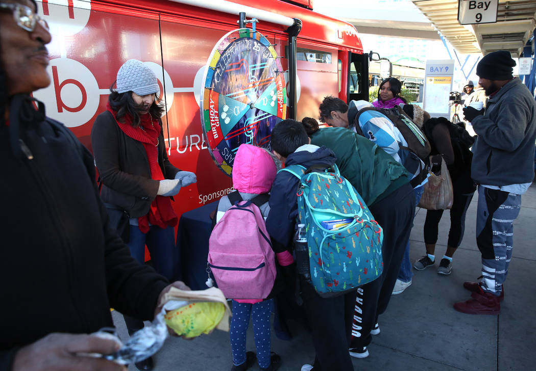 Commuters sign up to spin the wheel and win prizes at the Bonneville Transit Center, 101 E. Bonneville Ave., on Tuesday, Dec 5, 2017, in Las Vegas. The Regional Transportation Commission of Southe ...