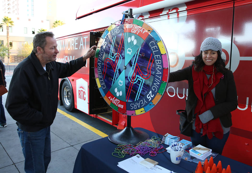 Dale Herd spins the wheel at the Bonneville Transit Center, 101 E. Bonneville Ave., as Ericka Aviles, right, of RTC community outreach, looks on Tuesday, Dec 5, 2017, in Las Vegas. The Regional Tr ...
