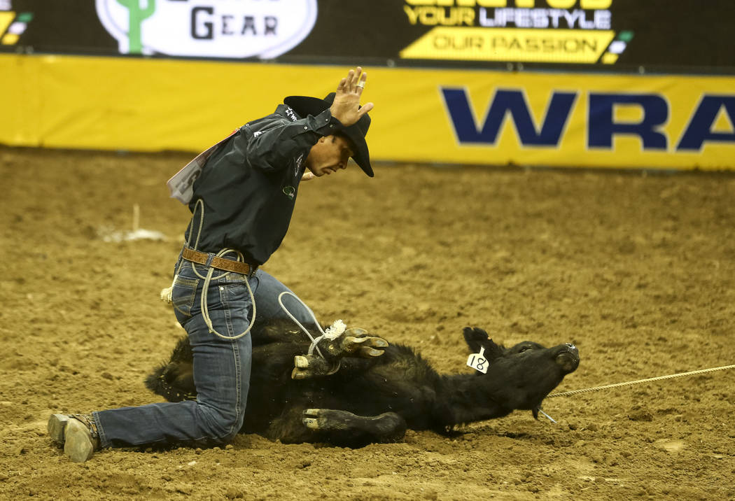 Marco Costa of Childress, Texas competes in the tie-down competition during the eighth go-round of the National Finals Rodeo, Thursday, Dec. 14, 2017, at the Thomas & Mack Center in Las Vegas. ...