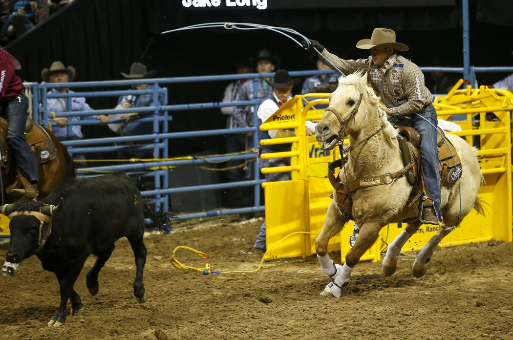 Luke Brown of Stephenville, Texas takes part in the team roping competition during the ninth go-round of the National Finals Rodeo, Friday, Dec. 15, 2017, at the Thomas & Mack Center in Las Ve ...