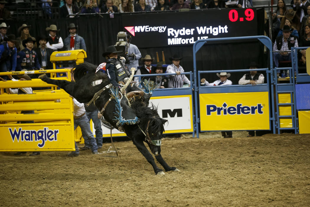 Ryder Wright of Milford, Utah rides Kitty Whistle in the saddle bronc riding competition during the ninth go-round of the National Finals Rodeo, Friday, Dec. 15, 2017, at the Thomas & Mack Cen ...