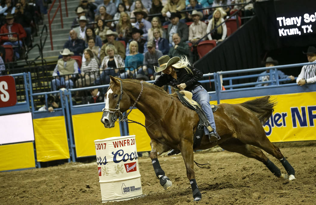 Tiany Schuster of Krum, Texas takes part in the barrel racing competition during the ninth go-round of the National Finals Rodeo, Friday, Dec. 15, 2017, at the Thomas & Mack Center in Las Vega ...