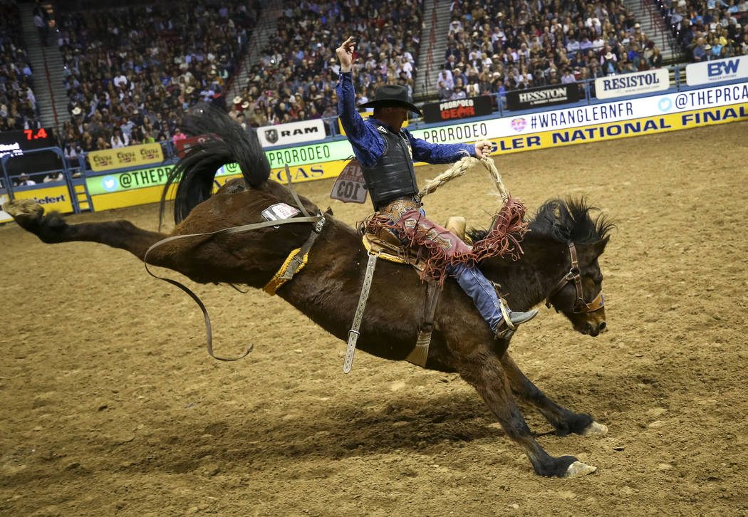 Audy Reed of Spearman, Texas rides Artificial Colors in the saddle bronc riding competition during the ninth go-round of the National Finals Rodeo, Friday, Dec. 15, 2017, at the Thomas & Mack  ...