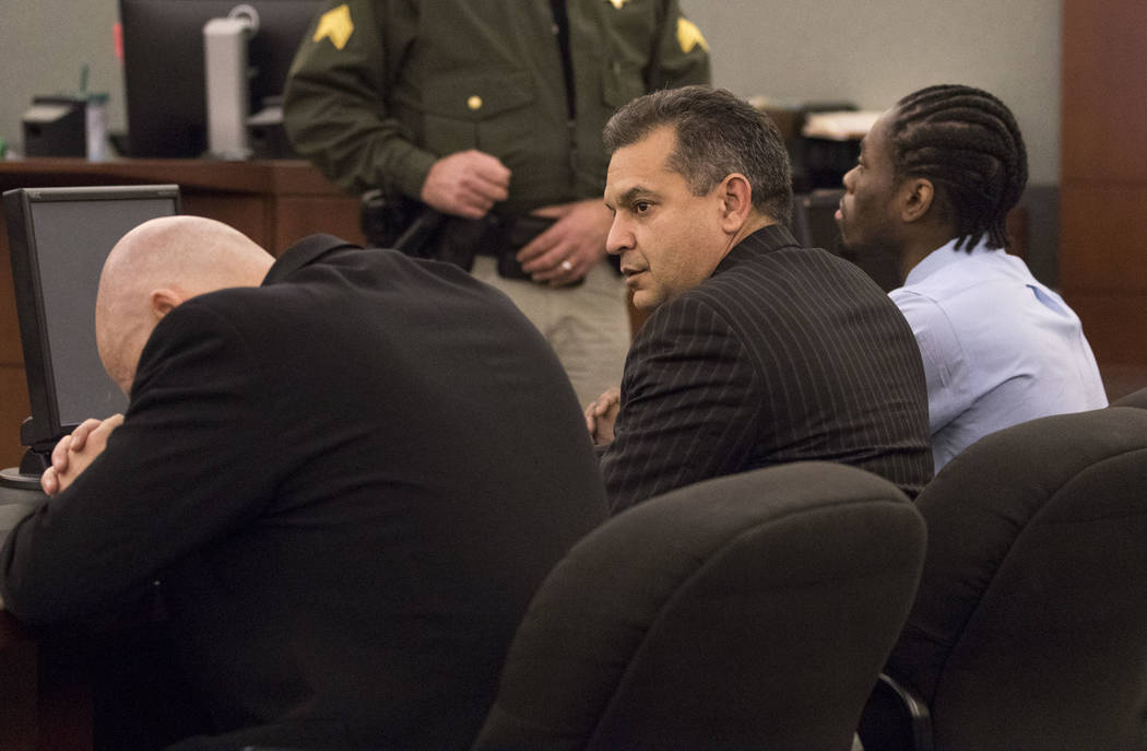 Defense attorney's Tony Sgro, from left, bows his head as Christopher Oram look at the jury after Bryan Clay's life sentence verdict at the Regional Justice Center in downtown Las Vegas on Tuesday ...
