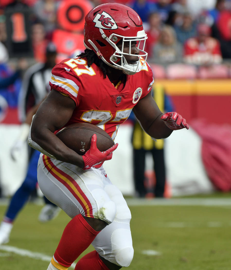 Kansas City Chiefs running back Kareem Hunt (27) carries the ball during the first half of an NFL football game against the Buffalo Bills in Kansas City, Mo., Sunday, Nov. 26, 2017. (AP Photo/Ed Z ...