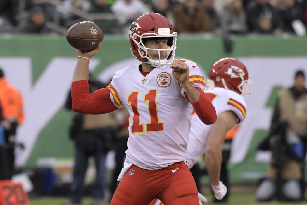 Kansas City Chiefs quarterback Alex Smith looks to throw during the first half of an NFL football game against the New York Jets, Sunday, Dec. 3, 2017, in East Rutherford, N.J. (AP Photo/Bill Kost ...