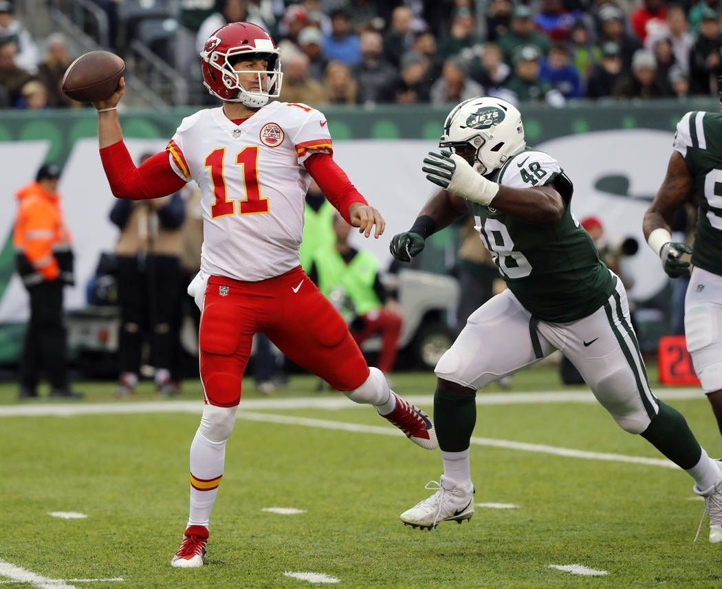 FILE - In this Dec. 3, 2017, file photo, Kansas City Chiefs quarterback Alex Smith throws during the first half of an NFL football game against the New York Jets in East Rutherford, N.J. The Chief ...