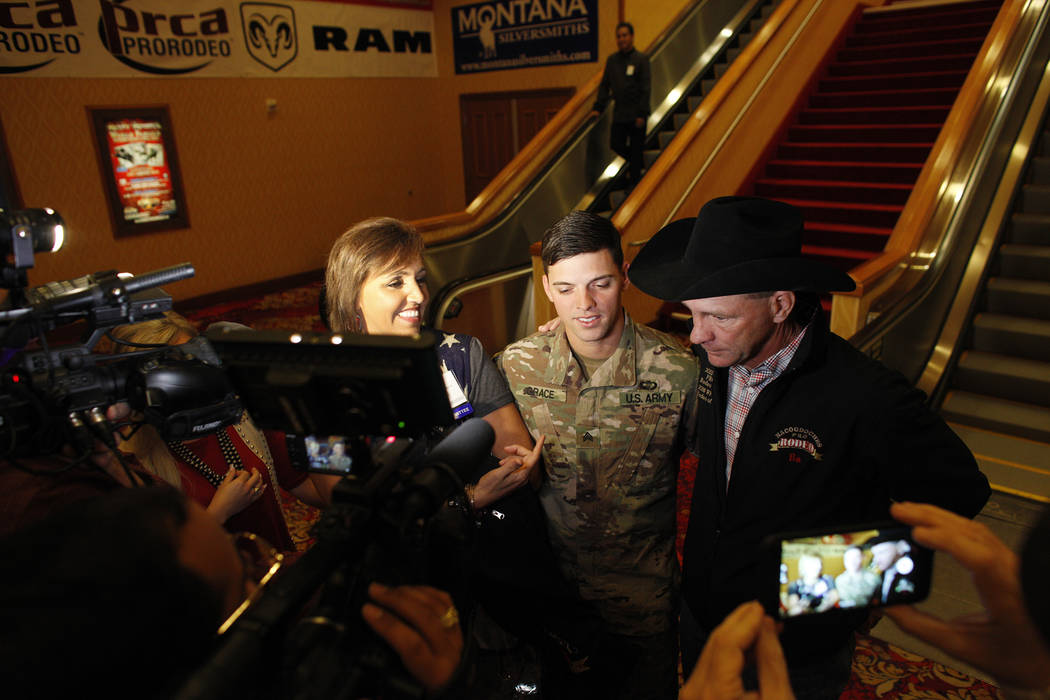 Anita Scott, from left, Sgt. Timothy Grace, and his stepfather Bo Scott talk to the media at the South Point in Las Vegas, Tuesday, Dec. 5, 2017. Anita arranged to surprise Bo of Grace's return fr ...