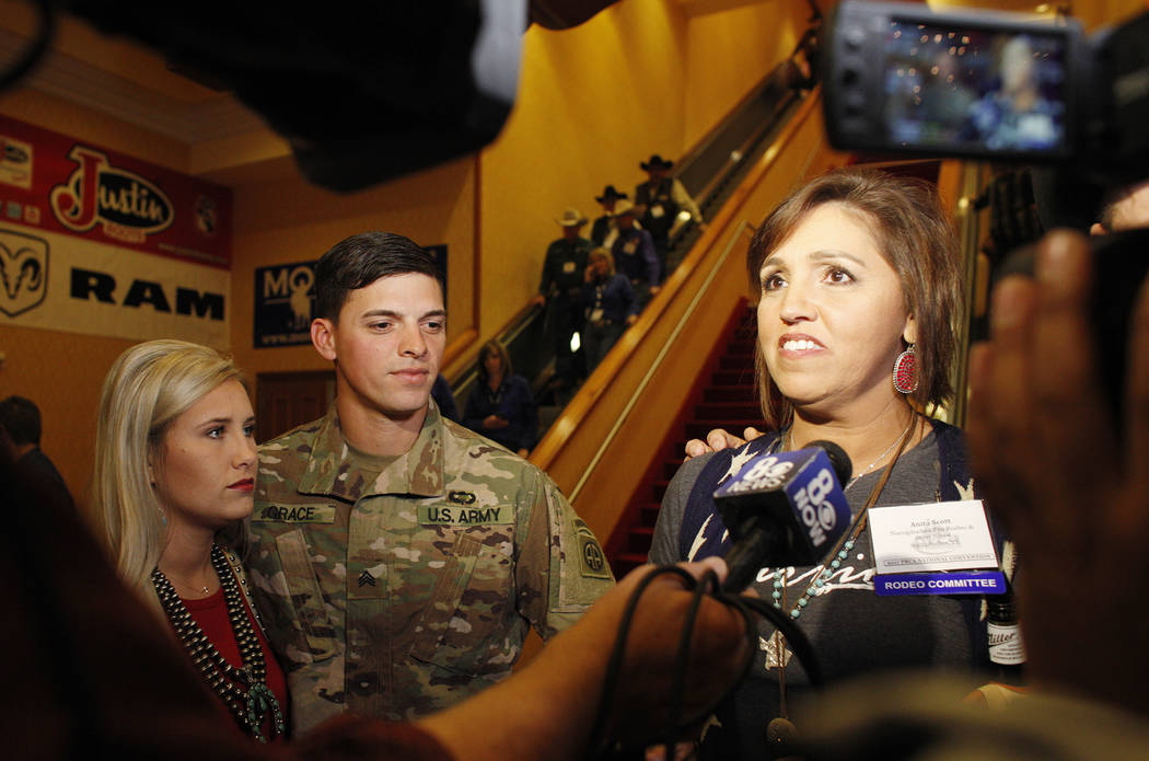 Sgt. Timothy Grace stands with his wife Bailey Grace as his mom, Anita Scott, talks to the media at the South Point in Las Vegas, Tuesday, Dec. 5, 2017. Anita arranged to surprise Bo, Grace's step ...