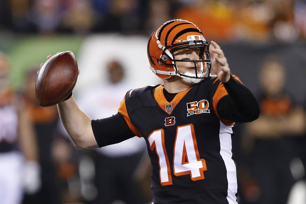 Cincinnati Bengals quarterback Andy Dalton passes in the first half of an NFL football game against the Pittsburgh Steelers, Monday, Dec. 4, 2017, in Cincinnati. (AP Photo/Gary Landers)