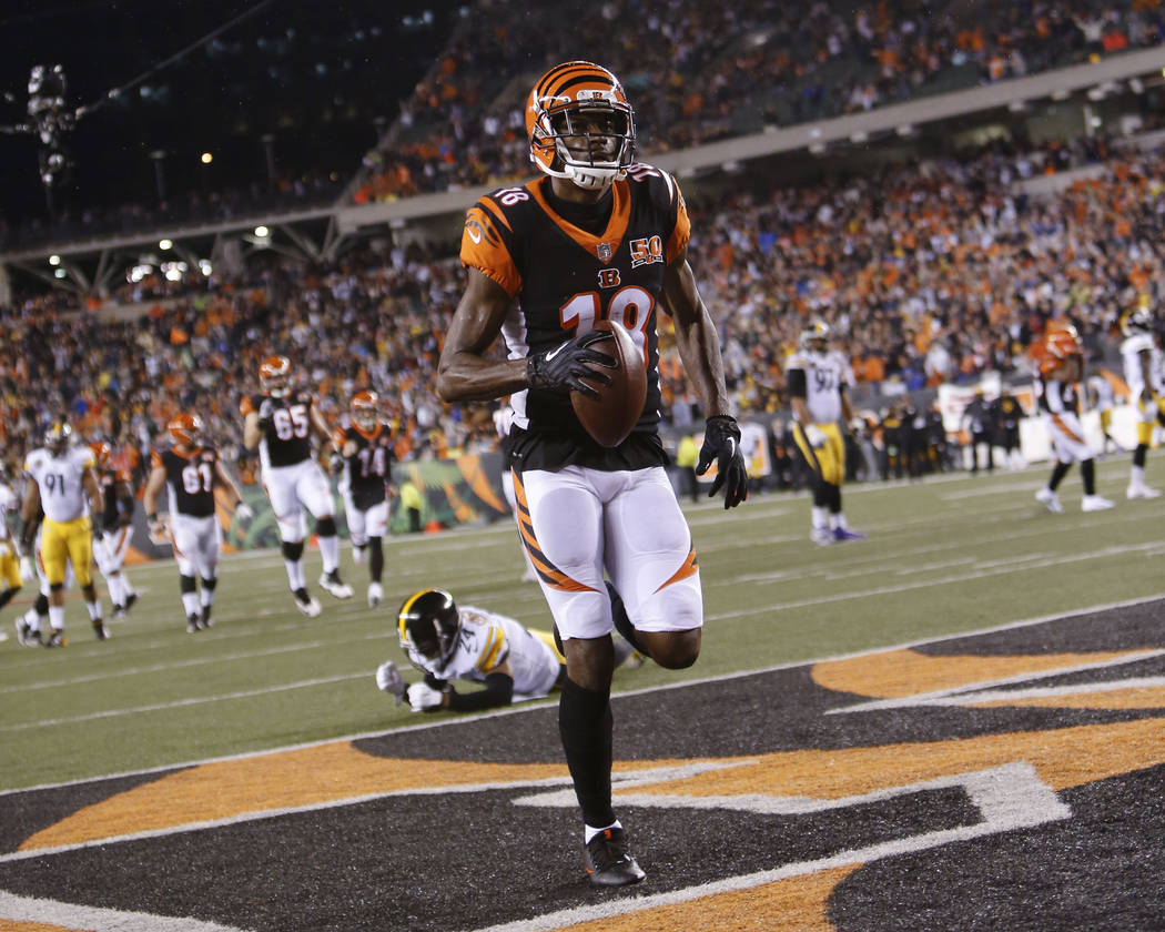 Cincinnati Bengals wide receiver A.J. Green (18) runs in a touchdown against Pittsburgh Steelers cornerback Coty Sensabaugh (24) in the first half of an NFL football game, Monday, Dec. 4, 2017, in ...