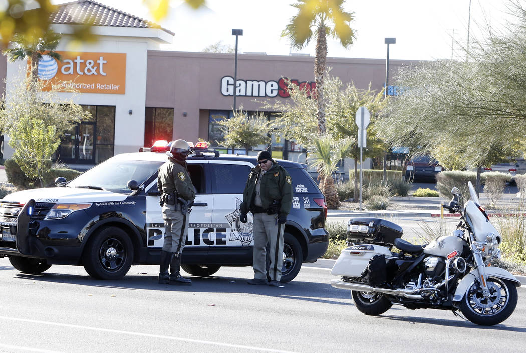 Las Vegas police investigate after a woman was hit by a pickup at Boulder Highway and Nellis Boulevard, Tuesday, Dec 5, 2017, in Las Vegas. The woman was crossing Boulder Highway when she was stru ...