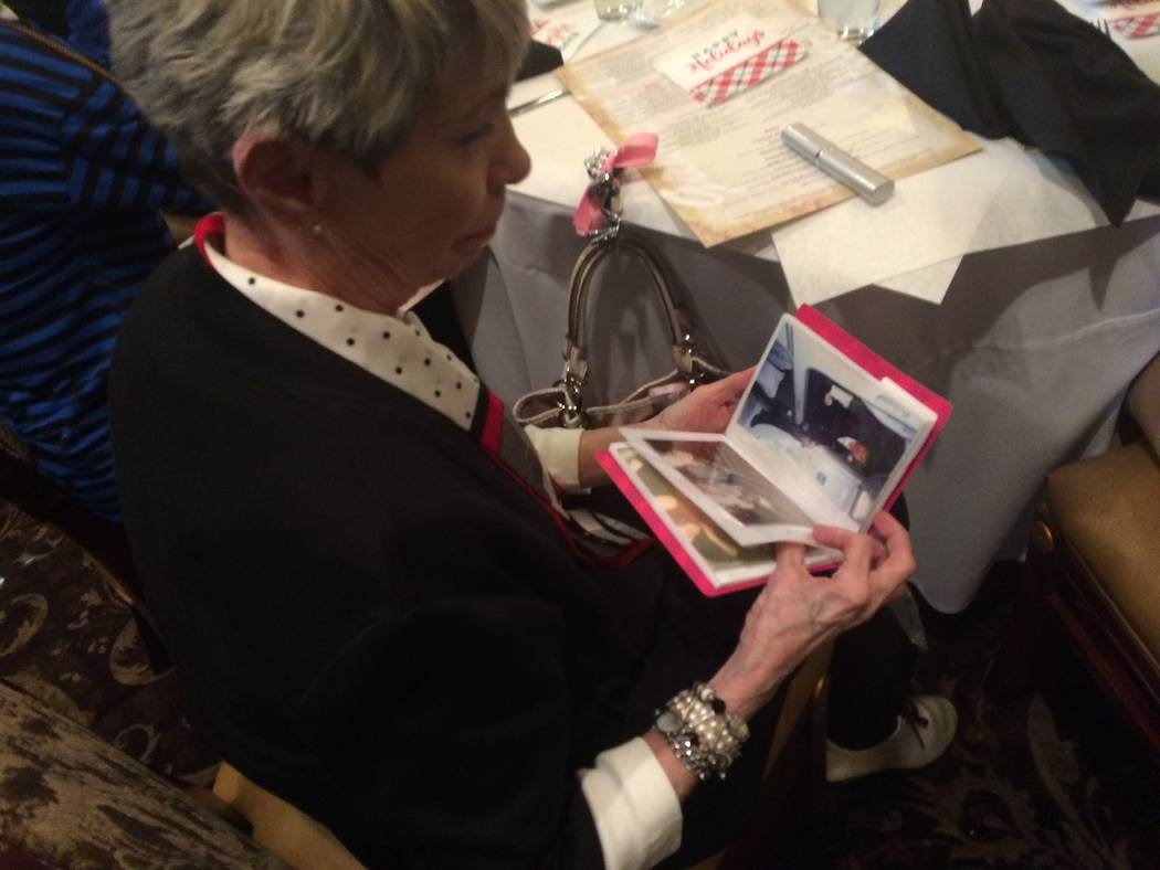 Sandy Coe looks at a photo album with shots of when she was a flight attendant for American Airlines. She and her identical twin sister Judy, now deceased, often worked the same flights, creating  ...