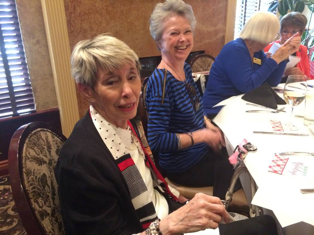 Sandy Coe (foreground) talks about her days as a flight attendant for American Airlines. She and her identical twin sister, Judy, now deceased, often worked the same flights, creating confusion fo ...