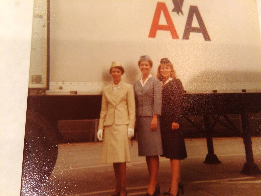 Sandy Coe (in white) poses in this undated snapshot from her days as a flight attendant for American Airlines. She and her identical twin sister, Judy, often worked the same flights, creating conf ...