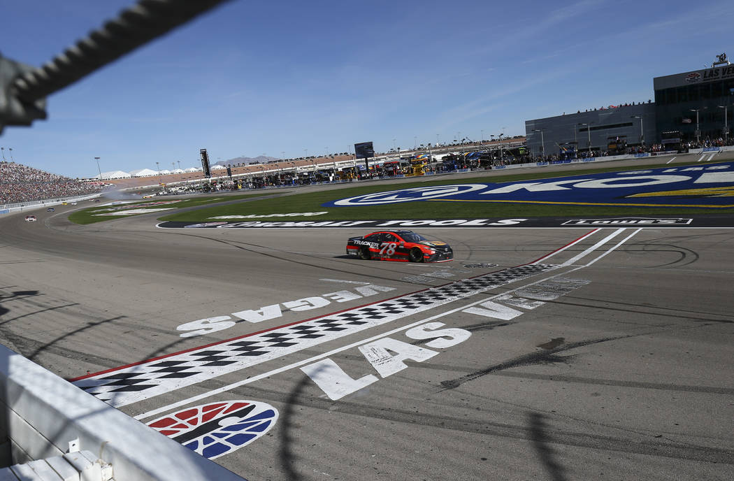 Martin Truex Jr. (78) approaches the finish line to win the Monster Energy NASCAR Cup Series Kobalt 400 auto race at Las Vegas Motor Speedway in Las Vegas on Sunday, March 12, 2017. (Chase Stevens ...