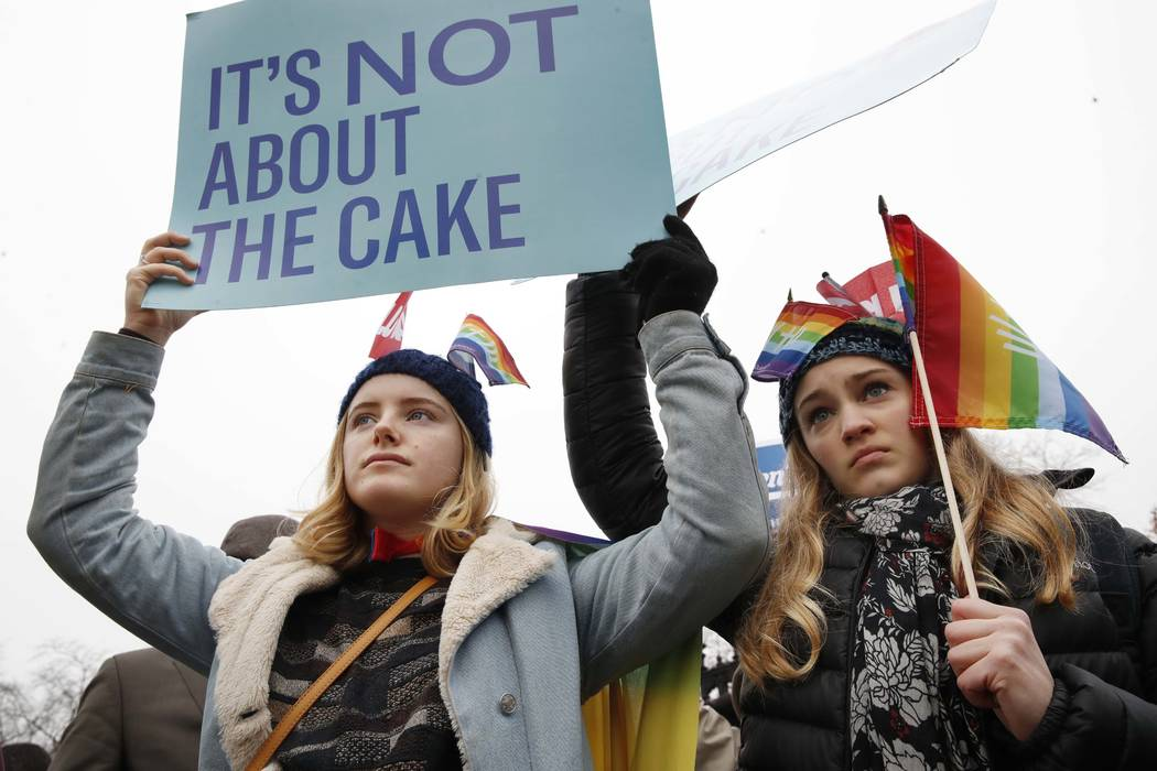Lydia Macy 17 left and Mira Gottlieb 16 both of Berkeley Calif. rally outside of the Supreme Court which is hearing the 'Masterpiece Cakeshop v. Colorado Civil Rights Commission&#039 today Tue